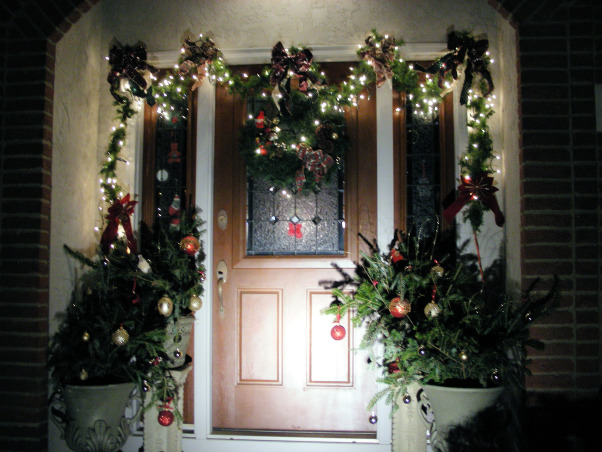 Symmetric Curb Appeal Winter Holidays, Changing entryway to reflect the wintry charm of the holiday season., A welcoming entrance for the holidays.  , Home Exterior Design