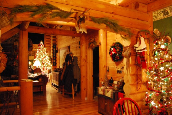 "Our Log Home Christmas 2012, It has been a few years since I have posted any pix of the interior decorations here at our log home deep in the secluded woods in the North Georgia Mountains. Thought I should get ""unlazy"" and post a few., View of two lit trees from the dining room into the great room            , Holidays Design"