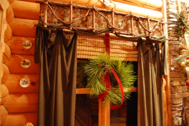 "Our Log Home Christmas 2012, It has been a few years since I have posted any pix of the interior decorations here at our log home deep in the secluded woods in the North Georgia Mountains. Thought I should get ""unlazy"" and post a few., Natural looking artificial wreaths with plaid ribbons hang from the two front windows in the great room            , Holidays Design"