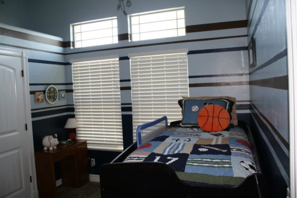 "Boys Brown/Blue Sports Room, This is my toddler's sports themed room.  It is a small, tall room and I had difficulty determining the best way to handle the walls.  I found another HGTV Rate my Space room that had the same bed spread and ""borrowed"" the paint stripes from that space.  I love feedback from people with more experience on how to improve so please don't hesitate to let me know if you have other / better ideas., It is a bit hard to get a picture of the entire room :) , Boys' Rooms Design"