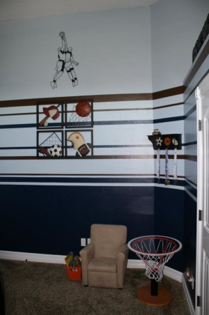 "Boys Brown/Blue Sports Room, This is my toddler's sports themed room.  It is a small, tall room and I had difficulty determining the best way to handle the walls.  I found another HGTV Rate my Space room that had the same bed spread and ""borrowed"" the paint stripes from that space.  I love feedback from people with more experience on how to improve so please don't hesitate to let me know if you have other / better ideas., Boys' Rooms Design"