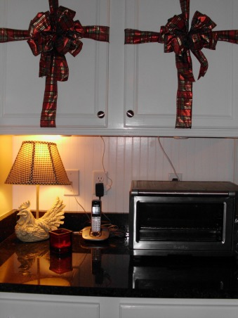 More changes to my kitchen, I took cheap, builder grade cabinets and painted them and added real wood beadboard over the particle board end cabinets and the island. , We not only added bead board to the cabinet ends but we made a back splash in the desk area.  , Kitchens Design