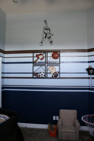 "Boys Brown/Blue Sports Room, This is my toddler's sports themed room.  It is a small, tall room and I had difficulty determining the best way to handle the walls.  I found another HGTV Rate my Space room that had the same bed spread and ""borrowed"" the paint stripes from that space.  I love feedback from people with more experience on how to improve so please don't hesitate to let me know if you have other / better ideas., The wall his bed is facing , Boys' Rooms Design"
