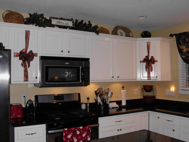More changes to my kitchen, I took cheap, builder grade cabinets and painted them and added real wood beadboard over the particle board end cabinets and the island. , My kitchen without the wallpaper backsplash and decorated for Christmas.  , Kitchens Design