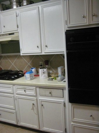 1950 small kitchen, We need makeover ideas-please help!  Our kitchen is roughly 12x12, with about 10 feet of countertop TOTAL.  The counters are disintegrating, and we have no space at all!  The floors are tile with the same tile backsplash.  We need ideas for cabinet color, new countertop type/color, and floor type/color.  We don't want to go too modern-the rest of the house has original wood floors and 50's style bathrooms., The wall oven, and no pantry!    , Kitchens Design