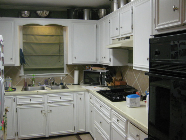 1950 small kitchen, We need makeover ideas-please help!  Our kitchen is roughly 12x12, with about 10 feet of countertop TOTAL.  The counters are disintegrating, and we have no space at all!  The floors are tile with the same tile backsplash.  We need ideas for cabinet color, new countertop type/color, and floor type/color.  We don't want to go too modern-the rest of the house has original wood floors and 50's style bathrooms., Looking in from the dining room, you see the one window.  I love the white cabinets, but with kids and dogs they're so hard to keep clean.  Notice all the pots above the cabinets-we have no space!  , Kitchens Design