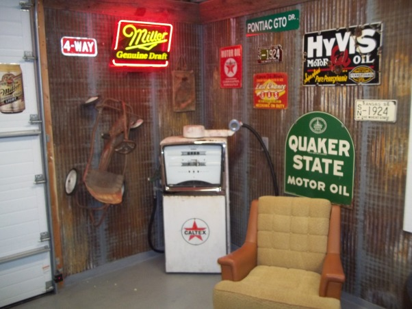 ManCave Poker Room, Renovated double car garage we made into our ManCave/poker room, Corner of the garage with some vintage signs and gas pump. Recycled metal on the walls from a barn. , Other Spaces Design