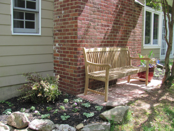 garden sitting area, overgrown and abandoned for several years after the original owner died, we had lots of work to do.... we cleared all the overgrown shrubs and did some landscaping.  we do all the design and execution ourselves., Home Exterior Design