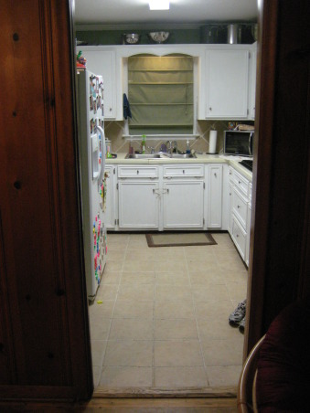 1950 small kitchen, We need makeover ideas-please help!  Our kitchen is roughly 12x12, with about 10 feet of countertop TOTAL.  The counters are disintegrating, and we have no space at all!  The floors are tile with the same tile backsplash.  We need ideas for cabinet color, new countertop type/color, and floor type/color.  We don't want to go too modern-the rest of the house has original wood floors and 50's style bathrooms., From the dining room looking in. You can see how narrow and small this space is. , Kitchens Design
