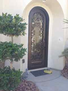 iron door entry, we replaced wood door with iron and glass. this door lets in lots of natural light. We also added Texas privet topiary to accent door.  The houses faces east , so this lets in morning light, and keeps it light in entry all through the day.  , Home Exterior   Design