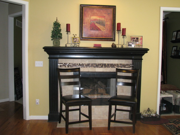 Ready for a cozy get-together!, My husband and I ripped our kitchen down to the bare bones, re-did the horrible layout,  and put in new cherry cabinets, granite countertops, tumbled stone backsplash, and new stainless gas range and microwave.  Everything was DIY except running the gas line and installing the granite. Check out the before pic's. , Fireplace/Hearth area at end of kitchen with coordinating tumbled stone tiles and a decorative strip of glass tile.    , Kitchens Design