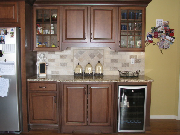 Ready for a cozy get-together!, My husband and I ripped our kitchen down to the bare bones, re-did the horrible layout,  and put in new cherry cabinets, granite countertops, tumbled stone backsplash, and new stainless gas range and microwave.  Everything was DIY except running the gas line and installing the granite. Check out the before pic's. , Installed a built-in buffet area with a wine/beverage cooler to assist with traffic flow during entertaining.   , Kitchens Design