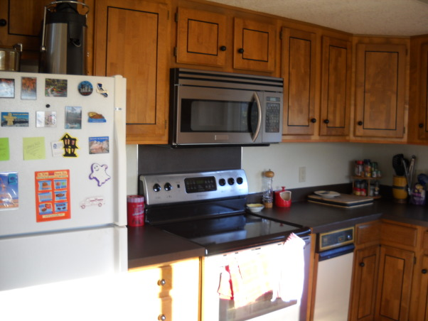 how would you remodel this kitchens - so you could use the view better, this is my - rental house.  the house need to be update so I can get more in rent., Kitchen stove -  , Kitchens Design