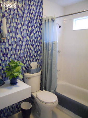 LOG CABIN to ROCKIN' BLUE, We took this small upstairs hall bathroom done in early Abe Lincoln and created  a contemporary master bathroom after combining the two small upstairs bedrooms in to a single large master bedroom. Rockin the glass wall tile, Now:  Wall of blue glass tile    , Bathrooms Design