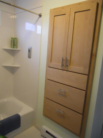"LOG CABIN to ROCKIN' BLUE, We took this small upstairs hall bathroom done in early Abe Lincoln and created  a contemporary master bathroom after combining the two small upstairs bedrooms in to a single large master bedroom. Rockin the glass wall tile, Added this built in storage / linen cabinet with two  12"" deep drawers.  On the shower wall is the Digital Interface for the showers body spray heads , Bathrooms Design"