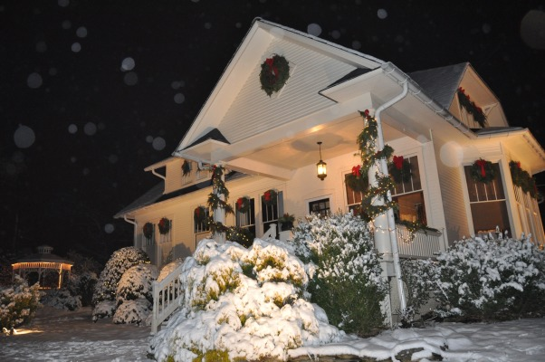 A White Christmas Bungalow Decorated for the Holidays, Exterior of home with homemade wreaths and Christmas decorations and the snow of Christmas Eve, Holidays Design