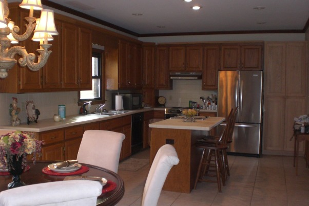 My $5000 kitchen makeover!, My home was built in 1986 and it showed in the kitchen! Drab oak cabinets and tile countertops. Yuck!  My father-in-law added a few boards to the top of the cabinets and recycled the crown molding. A few gallons of paint, new hardware, new granite countertops and it is a showplace!, This was my 1980's kitchen before--drab, outdated, just plain ugly. , Kitchens Design