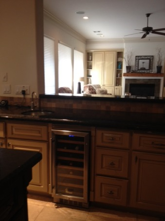 KitchenUpdate, Kitchen had bright yellow cabinetry. Updated cabinets with paint, added window treatments and new decor, Added a dual zone wine refridgerator. Cabinets in family room painted to match kitchen , Kitchens Design