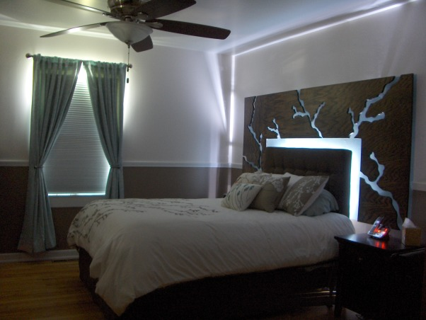 Bedroom with Floating Headboard, This space took inspiration from the bedding design of branches and leaves., Bedrooms Design