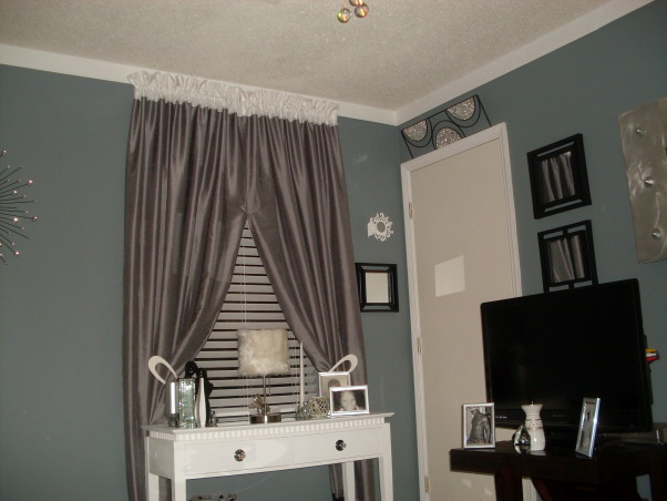 Den / Sitting area, Den/entertainment room , Curtains were added for sophistication.    , Other Spaces Design