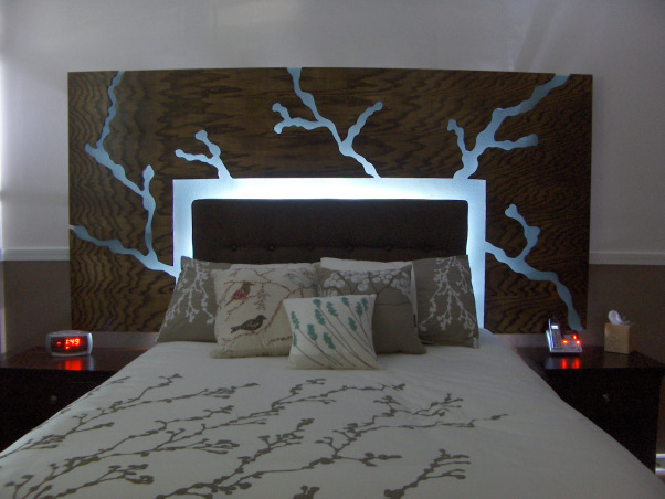 Bedroom with Floating Headboard, This space took inspiration from the bedding design of branches and leaves., Floating headboard that lights to create further ambiance in the bedroom.  The cut out design was inspired from the bedding., Bedrooms Design