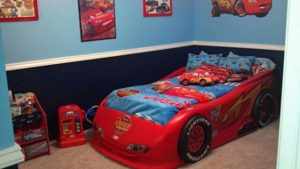 Disney's Cars Room for Felix , Disney Cars to the max! This room is for my 3 year old little boy. This room was done on a small budget. I purchased most of the furniure off Craigslist. My husband painted a lot of things to match the decor. With exception of the decals ( decals also purchased off craigslist) most of the decor was DIY. This room took a long time to complete because waiting for the deals took patience. It was sooo worth it seeing my little boys expression when he walked into his new room. We kept the project from him so he was totally shocked. , This bed including the mattress cost $70. off craigslist. This stickers are a little worn but I was very happy to find this so cheap!, Boys' Rooms Design