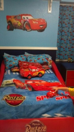 Disney's Cars Room for Felix , Disney Cars to the max! This room is for my 3 year old little boy. This room was done on a small budget. I purchased most of the furniure off Craigslist. My husband painted a lot of things to match the decor. With exception of the decals ( decals also purchased off craigslist) most of the decor was DIY. This room took a long time to complete because waiting for the deals took patience. It was sooo worth it seeing my little boys expression when he walked into his new room. We kept the project from him so he was totally shocked. , I made the pillows. I also was given this blanket when my son was born that matched perfectly. , Boys' Rooms Design