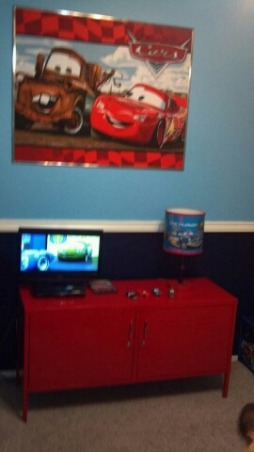 Disney's Cars Room for Felix , Disney Cars to the max! This room is for my 3 year old little boy. This room was done on a small budget. I purchased most of the furniure off Craigslist. My husband painted a lot of things to match the decor. With exception of the decals ( decals also purchased off craigslist) most of the decor was DIY. This room took a long time to complete because waiting for the deals took patience. It was sooo worth it seeing my little boys expression when he walked into his new room. We kept the project from him so he was totally shocked. , We made this using a piece of fabric wrapped around foam board. My husband made the trim for the picture. I love it!, Boys' Rooms Design