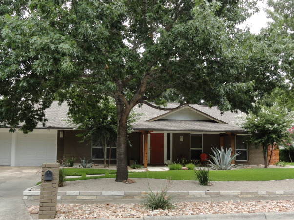 Ranch Redo, We updated our 1960's ranch. Took down the shutters and dying holly bushes, painted the brick, enlarged the patio, changed the posts, re-routed the walkway, changed the lights, added house numbers, side fences, retaining walls, and rock beds., Home Exterior        Design