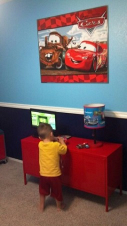 Disney's Cars Room for Felix , Disney Cars to the max! This room is for my 3 year old little boy. This room was done on a small budget. I purchased most of the furniure off Craigslist. My husband painted a lot of things to match the decor. With exception of the decals ( decals also purchased off craigslist) most of the decor was DIY. This room took a long time to complete because waiting for the deals took patience. It was sooo worth it seeing my little boys expression when he walked into his new room. We kept the project from him so he was totally shocked. , IKEA locker $100. , Boys' Rooms Design
