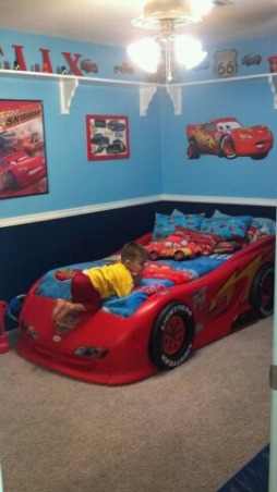 Disney's Cars Room for Felix , Disney Cars to the max! This room is for my 3 year old little boy. This room was done on a small budget. I purchased most of the furniure off Craigslist. My husband painted a lot of things to match the decor. With exception of the decals ( decals also purchased off craigslist) most of the decor was DIY. This room took a long time to complete because waiting for the deals took patience. It was sooo worth it seeing my little boys expression when he walked into his new room. We kept the project from him so he was totally shocked. , I chose the 2 shades of blue because of the contrast that was made with the red. When I was looking at CARS rooms that were painted in red or yellow I didn't like the extreme loudness of the colors. , Boys' Rooms Design
