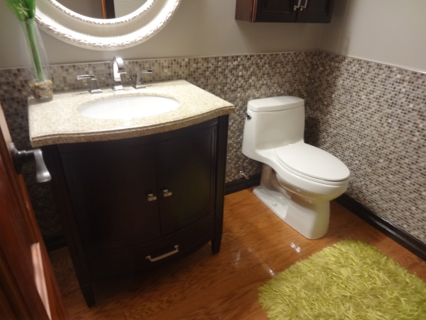 Powder room with style and glam, This cozy 2 pc off the garage of our newly purchased lake home features many updates..., This granite top vanity and undermount sink has the rich dark wood cabinet with curved doors and bottom drawer, great for extra storage.  , Bathrooms Design