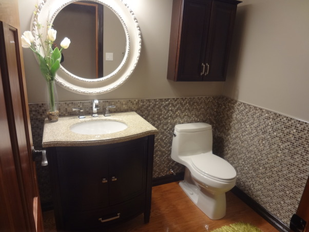 Powder room with style and glam, This cozy 2 pc off the garage of our newly purchased lake home features many updates..., Check out this 2 pc bath with a Kohler 1pc toilet, custom tile just to add some Bling...   , Bathrooms Design