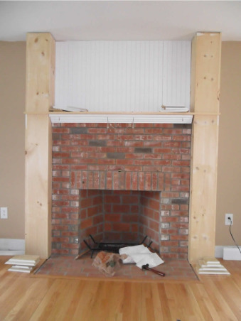 Pauls Family room, Was a plain builder white walls with an office in there... boring fireplace with no character.  Now it's beautiful, clean and elegant.  a place that feels relaxing and peaceful., beginning of our fire mantel project.   added bead board above , and pillars to the sides.   , Living Rooms Design