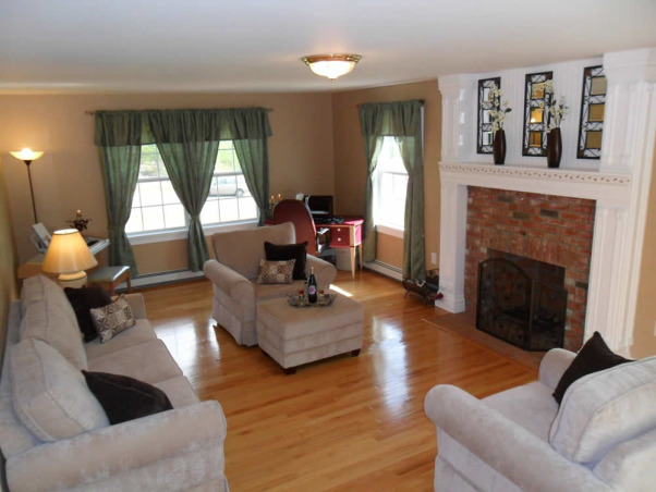 Pauls Family room, Was a plain builder white walls with an office in there... boring fireplace with no character.  Now it's beautiful, clean and elegant.  a place that feels relaxing and peaceful., Love it.  , Living Rooms Design