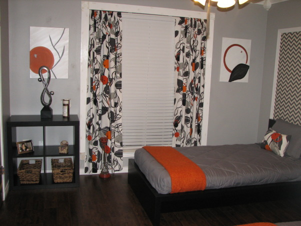 Guest Getaway for the Grand Kids , Just wanted a fun room that would accommodate both Grandson/Granddaughter while still allowing my college age daughter to come home and not be in a kiddie room.  The low profile beds  are great with gray and orange colors accents.  I wanted something a little different over the beds, so I framed out area and use a zigzag fabric.  I made the curtains in a coordinating fabric.  The orange mirror is a nice pop of color., Colorful curtains to coordinate with headboard fabric Pictures painted by me to match designs in curtains, Bedrooms Design