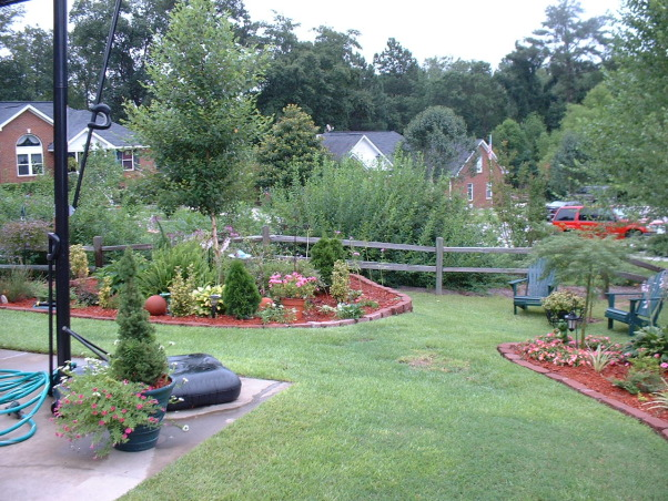 Garden Bug, Our back yard, we did all the work on the decks and in the yard, we had the pool put in, but I came up with the design since there was a hill. We hope you like it. This is our home in M.S. We've been here since Dec. of 2005. We came from S.C. I will put pictures of that home too., Yards Design