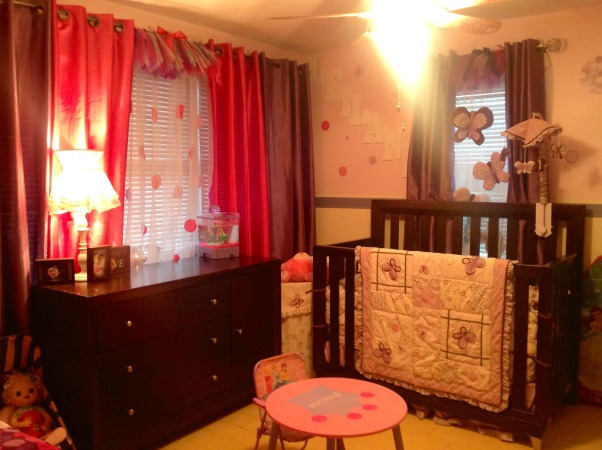 Dots and butterfly's , Shared bedroom/playroom between a 4 yr old and an infant.  The twin bed, the wall canopy and some of the window treatments are handmade . , Girls' Rooms Design