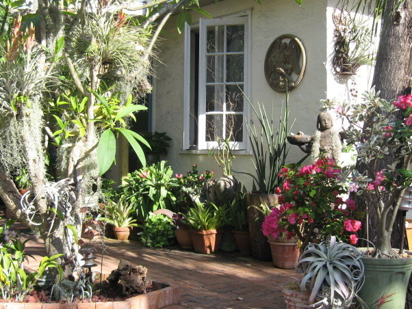 Tropical Treasure, I actually transformed this space for a couple of dear friends of mine. It was the gift of my labor and talent to them for their generosity.They let me stay in their home while i was in between my own spaces. , rustic brick pathways meander through orchid laden trees to this Quant tropical cottage. , Gardens Design