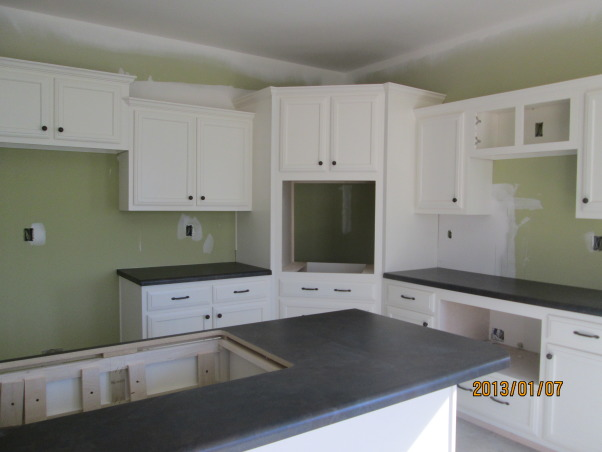 New kitchen, we are building a lake house. My appliances will be black but don't know if a black vent a hood would look ok with my white cabinets. What do y'all think?, My appliances are going to be black. Should the vent a hood be the same. I am just afraid that it will look funny with the white cabinets. What do y'all think?, Kitchens Design