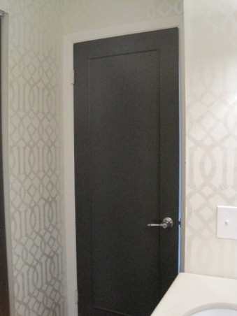 Powder Room: Style on a Budget, I put a lot of time into our powder room, as this is a space all you guests see!!  I didn't let a small budget keep me from creating exactly the space I wanted.  It just took some patience and a little DIY. www.confettiandstripesblog.com, I added molding to plain flat panel doors and then painted them a dark charcoal grey...they seem so much more luxe now.  Also changed out the door knobs!    , Bathrooms     Design