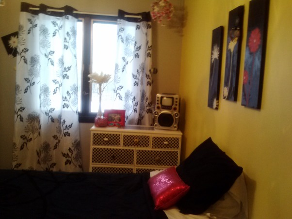 "Yellow, Gray, Pink, and Black Tween Room, Yellow, and light gray walls surround this tween room, and pink and black accents My daughter is full of sunshine and smiles, and I wanted a room that showcases that.  The black mini chandelier finishes the space, along with hand-painted art pieces, and a creative touch of ""contact paper"" to decorate her closet doors and dresser. I wish her room were bigger, but of course that I can't change! She is also a ""collector"" of ""stuff"", so there is more ""stuff"" in the room than I would like. But, I needed to let it be her room. :), Girls' Rooms Design"