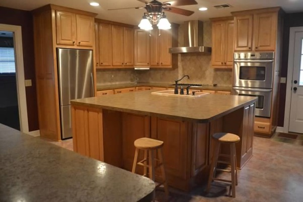 Please help spruce up my rental kitchen!, I'm renting this house sight-unseen (I live in Japan and the house is in Texas), and need to nail down wall colors before I can be in the house.  I cannot paint the cabinets, only the walls.  I like a country with a funky vintage twist.  I have no ties to any colors.  The walls in the adjoining rooms will be warm gray.  Thanks!, The kitchen.  What color do you think the counters are?  I know they're laminate.  They appear to have some pink in them, but it might be the wall color that is throwing me off., Kitchens Design