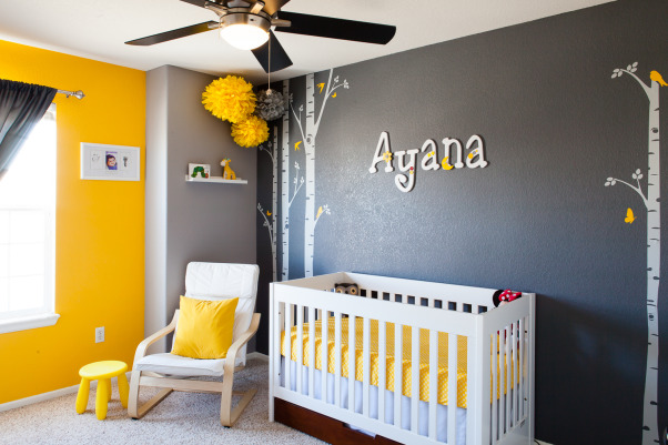 "Ayana's Sweet and Modern Nursery, I am a lover of contemporary living. Ever since I thought of making our daughter's nursery I was looking for something that looks modern and contemporary. After my rigorous research I finally settled down to ""Gray and Yellow"" theme, Gray was to give the room that elegance and Yellow was to diffuse that freshness and incandescence for a girl's room. I loved how the combination was vivid as well as graceful.  However, I wanted to keep a balance between splurging for the nursery and 'thinking too much'. I think I was able to get to it finally!  I got my inspiration from all the beautiful projects that have been submitted already. I had previously done my son's room, and I also wanted Ayana's room to be as pretty as she herself is.  Room Details- 1.	Wall Colors-  Behr (Twenty Carat, Cathedral Gray, and Manhattan Mist) 2.	Crib- Baby Mod 3.	Dresser- IKEA 4.	Changing Table- Pottery Barn 5.	Chair- American Furniture Warehouse 6.	Curtain- Bed Bath and Beyond 7.	Poms- Ebay 8.	Wall Decals- Etsy 9.	Birdhouse Lamp- DIY project 10.	Small Birdhouse- DIY project 11.	Door name tag- DIY Project 12.	Wall name letters-  I bought wooden letters off of Etsy and then painted and decorated them so it was partial DIY project. 13.	Wall shelf- IKEA 14.	Round Mirrors- Target 15.	Butterfly Mirror- Michaels 16.	Nursery Art- Gift from a friend 17.	Yellow Lamp- IKEA  **Thanks to my husband AJ Kumar for taking wonderful shots of the nursery!, Yellow-Gray poms and wall decals are one of my favorite features of the nursery, they play big part in giving the lively look  to her room.    , Nurseries Design"