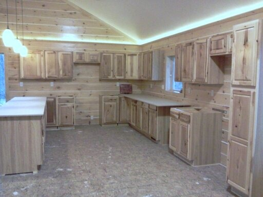 Building our new home, This is a picture of our kitchen as we are trying to finish it. We're building our home and it's just about done.  Regular house out, log cabin in.  , Our kitchen cabenits were just installed.  next comes the hardwood flooring.  Hickory of course.  , Other Spaces Design