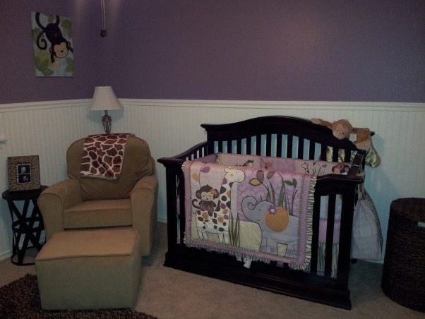 Emily's Simple Safari Nursery, With the nursery, I wanted it to be cute, simple, and not too pink! I fell in love with the bedding (Cocalo Jacana) from Babies R Us and thats where we started. My husband put up the wainscoting and then painted the walls purple. Then we had fun getting safari themed items to decorate with! I love how it turned out!, Nurseries        Design