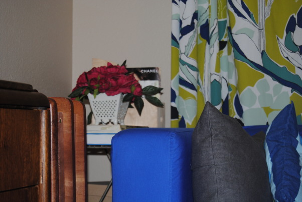 IKEA + me Family Room, Yes, I love color. Yes, I love IKEA. This room showcases both. I would--of course--love any positive feedback on my space, but also let me know if you have suggestions for small improvements. Thanks!, Silk flowers in a vintage-style planter add a pop of fuchsia and femininity to an otherwise cool palette and fairly gender-neutral space. , Living Rooms Design