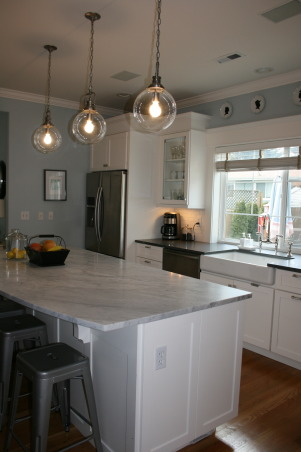 Seattle kitchen update, Traditional white kitchen with vintage and industrial elements., A full depth refrigerator and new side panels replace a much too small counter depth refrigerator to add functionality to this family kitchen.     , Kitchens     Design