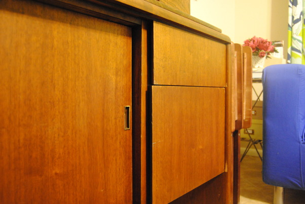 IKEA + me Family Room, Yes, I love color. Yes, I love IKEA. This room showcases both. I would--of course--love any positive feedback on my space, but also let me know if you have suggestions for small improvements. Thanks!, A closeup of the credenza. The doors slide open to reveal to sets of shelves, perfect for storing photo albums, CDs, and DVDs. The drawers hide cords, extra controllers, and video games. We even found a key to lock one side--my curious son discovered the lock for the left side of the credenza matches the key for my vintage Lane cedar chest. , Living Rooms Design