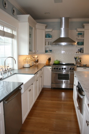 Seattle kitchen update, Traditional white kitchen with vintage and industrial elements., A farmhouse sink was retrofitted into the existing sink base cabinet and a bridge faucet was added.  A  microwave drawer was added to the island.   , Kitchens     Design
